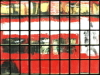 London bus through church window image